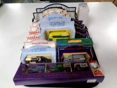 A tray containing assorted die cast vehicles to include Railway Express parcel vans, Hamley's,