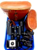 A tray of two pairs of leather cased binoculars by Silraft and Viper,
