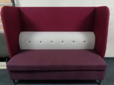 A contemporary high backed booth settee upholstered in a two-tone purple and grey fabric