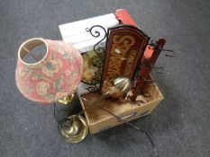 A box containing new wall clocks, angle poise lamp, brass table lamp with shade,