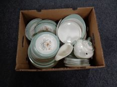 A box containing a Wedgwood Tiger Leaf dinner service