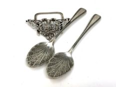 A pair of Victorian silver jam spoons and an ornate silver menu stand (3)