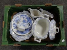 A box containing seven pieces of 19th century blue and white dinner ware