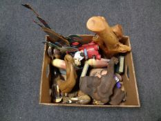 A box containing wooden animal ornaments to include fish bookends, ducks,