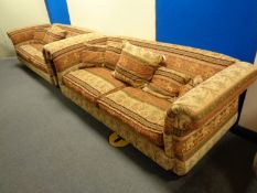 A pair of contemporary oversized scroll arm settees upholstered in an Indian style fabric