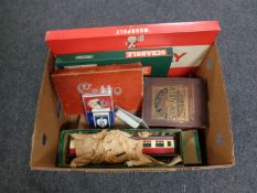 A box containing vintage and later games, a large scale tin plate train carriage, stamp album,