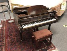 A mahogany cased baby grand piano by Altona, 140 cm wide,