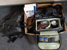 A box of video cameras in bags, camera bags,