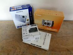 Three boxed digital cameras to include Canon Powershot A630,