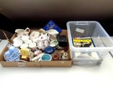 A box of assorted china to include commemorative ware, dressing table brushes, harmonica with book,