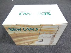 A boxed Sew Land over locking sewing machine