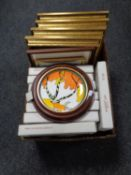 A box containing gilt framed prints,