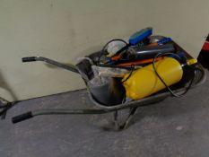 A wheelbarrow containing garden sprayers,