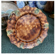An 18th century Whieldon pottery plate. CONDITION REPORT: Stapled.