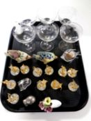 A tray containing a set of six etched champagne glasses, brass and crystal mice band figures,