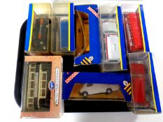 A tray containing 10 boxed Corgi die cast vehicles to include trams,