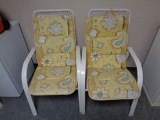 Four metal stacking garden armchairs with cushions