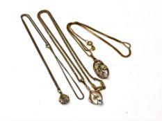 Three 9ct gold pendants on chains,