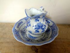 A Chinese blue and white miniature wash jug and basin