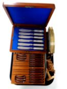 A tray containing an Edwardian canteen of fish cutlery together with a set of teak handled cutlery,
