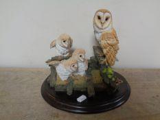 A Royal Doulton sculpture of a barn owl family,