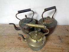 Three antique copper and brass kettles