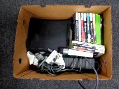 A box containing an X Box 360, leads,