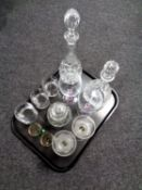 A tray containing two lead crystal decanters with stoppers together with assorted drinking glasses,