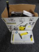 A Karcher K2 pressure washer with accessories together with a Karcher window vac
