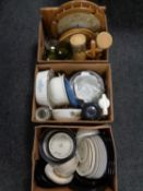 Three boxes containing assorted dinner plates and bowls, kitchen storage jars,