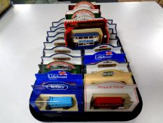 A tray containing approximately 25 die cast vehicles to include Models of yesteryear, Hamley's,