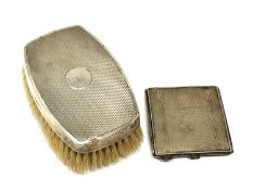A silver compact with engine turned decoration,