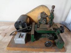 A vintage key cutting machine