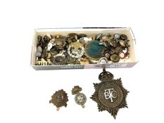 A box containing a quantity of military badges and buttons, British Transport Commission cap badge,