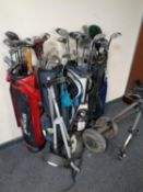 Four golf bags containing assorted irons and drivers to include Donnay, Howson, Hippo etc,