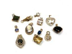 Twelve 9ct gold pendants. CONDITION REPORT: 22.