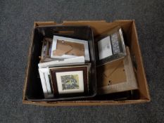A box containing a quantity of new picture frames