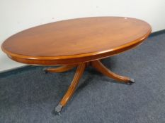 A Bradley Furniture reproduction oval yew wood pedestal coffee table