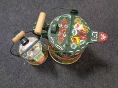 Two painted metal barge watering cans
