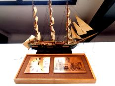 A wooden model of a 19th century clipper together with a 1970's teak framed copper and etched panel