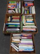 Five boxes containing hardback and paperback books to include dictionaries, cookery,