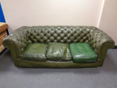A green button leather Chesterfield three seater club settee (odd cushion)