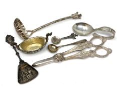 A group of silver and other items including caddy spoon, strainer, salt,