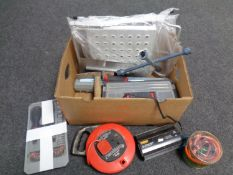 A box containing toolbox and tools, extension lead, folding step, torque wrench,