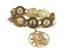 An oriental gold bracelet and a similar pendant (each stamped '14kt' but not testing higher than