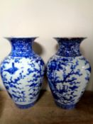 A pair of Chinese blue and white glazed ceramic vases depicting flowers, height 31.