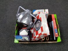 A box of miscellany to include a Cyberman helmet, Harry Potter audio CD's, stamp albums,