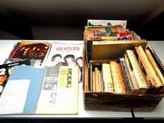 A box of a large quantity of books and calendars relating to The Beatles,