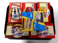 A tray containing seven Corgi die cast buses and trams (boxed)