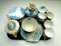 Two trays of antique Rosebery china tea service together with a tray containing vintage tin,
